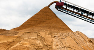 A conveyor pours crushed sand into a stockpile before it is washed and sorted by grain class size at Preferred Sands mine in Blair, WI, on June 20, 2012. Lukas Keapproth/Wisconsin Center for Investigative Journalism