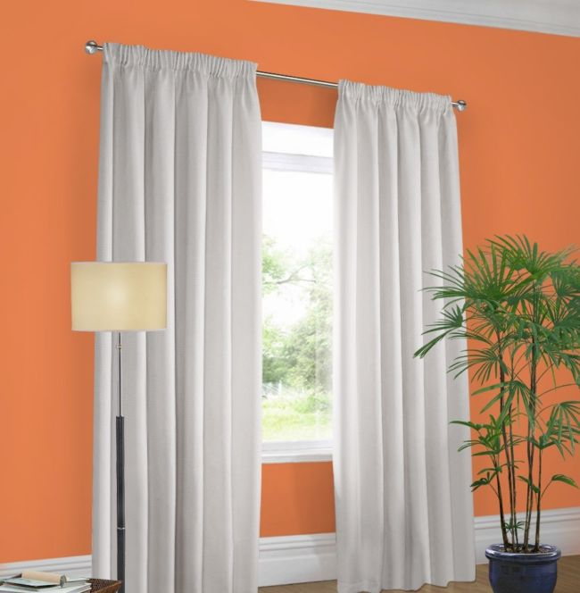 Orange wall white curtains