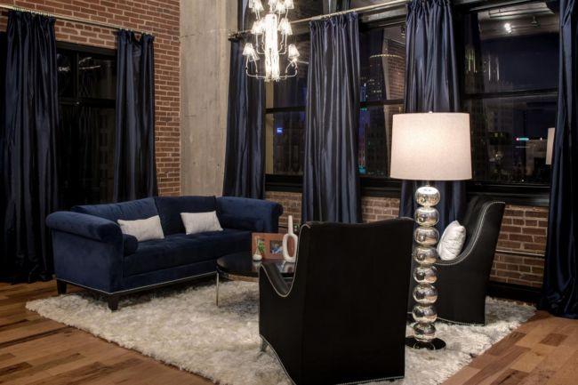 SK-Interiors_Downtown-Loft-blue-modern-bedroom-couch_h.jpg.rend.hgtvcom.1280.853