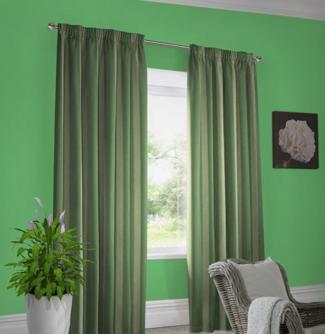 The green walls dark green curtains striped khaki