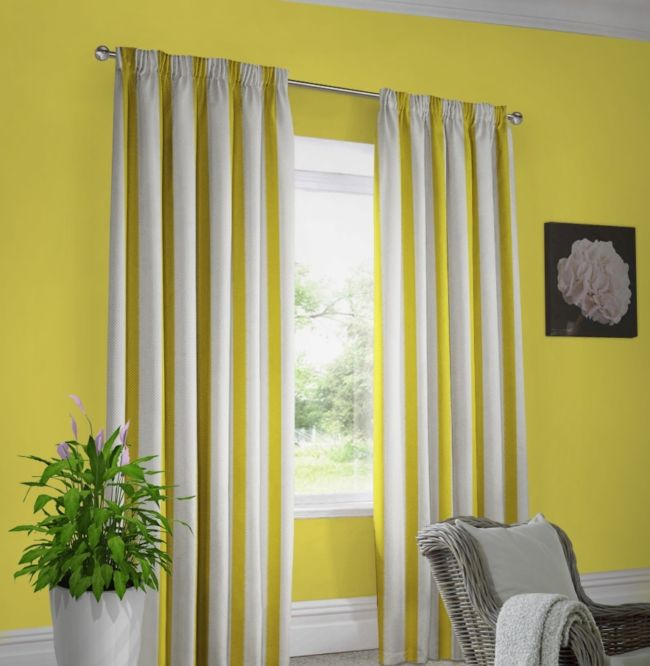 Yellow walls white curtains in dark yellow stripes