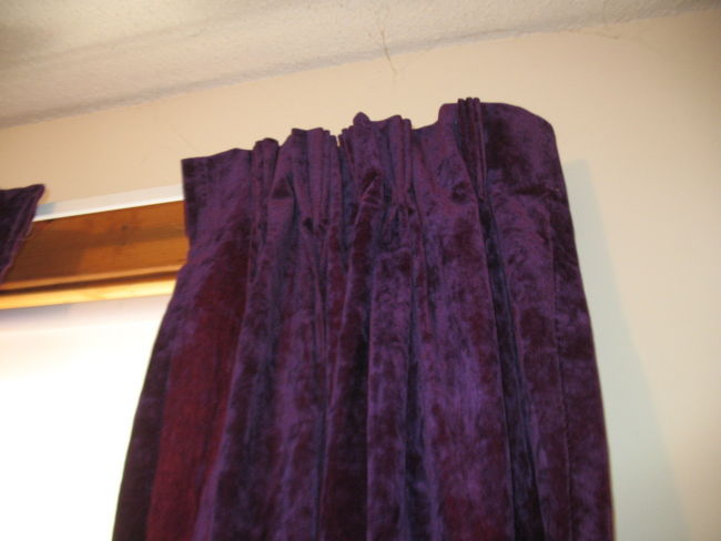 dark-purple-velvet-curtain-with-wooden-rod