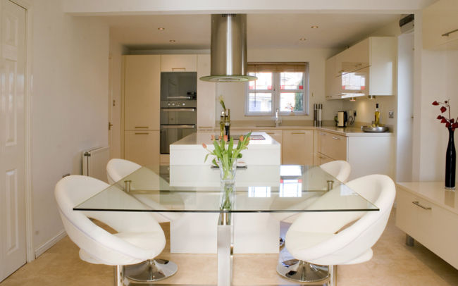 luxury-glass-top-dining-table-with-flower-centrepiece-feat-modern-white-kitchen-chairs-plus-round-exhaust-hood