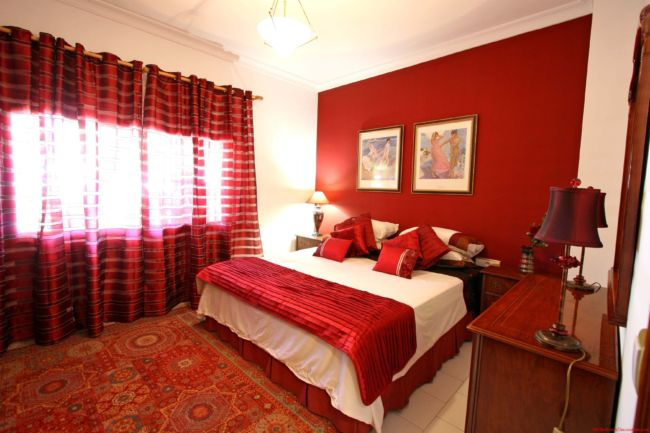 modern-nice-design-of-the-bedroom-decor-with-red-and-brown-that-has-white-mattras-can-be-decor-with-red-curtains-can-add-the-beauty-inside-it-seems-nice-with-lamp